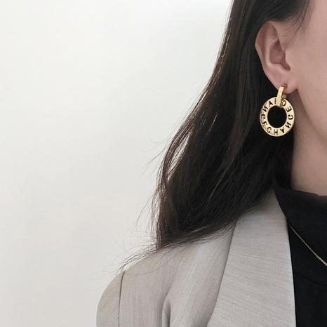 wholesale lettres creuses boucles d'oreilles en acier titane plaqué or Nihaojewelry NHGC395420's discount tags