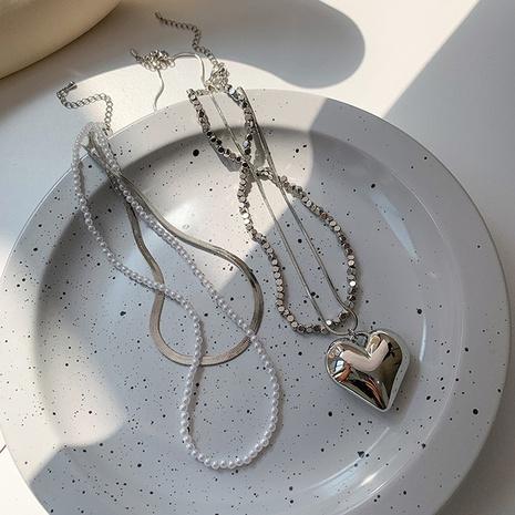 Collier en cuivre empilé en os de serpent avec épis de coeur simple en gros Nihaojewelry NHMS395729's discount tags