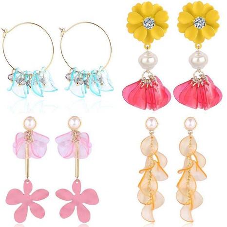 Whoelsale Boucles d'oreilles pompon fleur Boucles d'oreilles pompon pétales coréens NHQC396328's discount tags