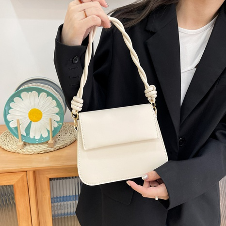 solid color twist shoulder strap korean style underarm handbag wholesale Nihaojewelry NHGN407251's discount tags