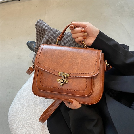 Retro lock flip one-shoulder messenger small square bag wholesale Nihaojewelry NHGN407924's discount tags