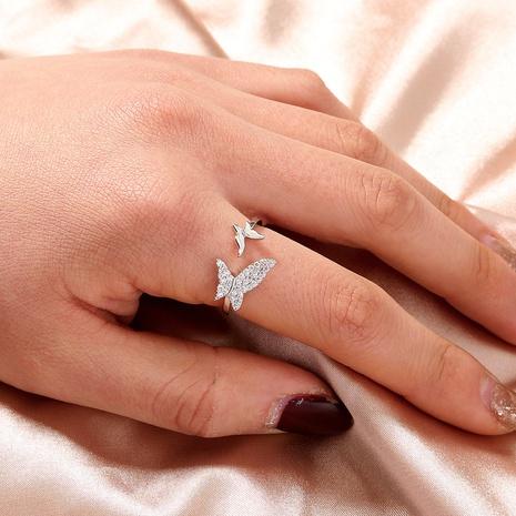 anillo de apertura con incrustaciones de mariposa de color sólido de moda al por mayor nihaojewelry NHDB408204's discount tags