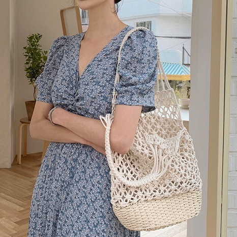 retro hollow straw woven solid color bucket bag wholesale nihaojewelry NHXM409038's discount tags
