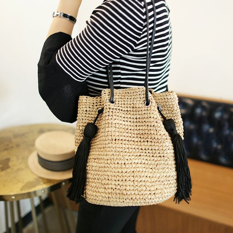 new fashion tassel straw woven shoulder bucket bag wholesale nihaojewelry NHXM409048's discount tags