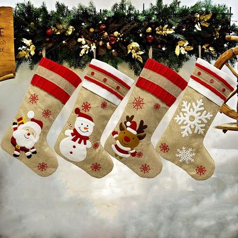 Nuevo muñeco de nieve ciervos copo de nieve calcetines de lino decoraciones navideñas al por mayor Nihaojewelry NHGAL411485's discount tags