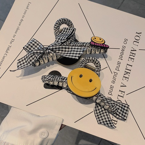 Korean smiley face bow plaid hairpin wholesale Nihaojewelry NHOF412687's discount tags