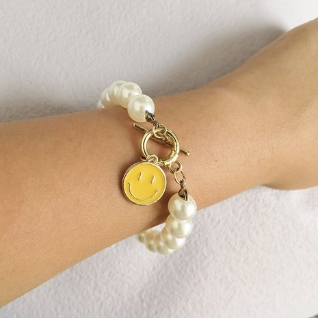 new creative alloy drip smiley face pearl bracelet wholesale Nihaojewelry  NHYIA413522's discount tags