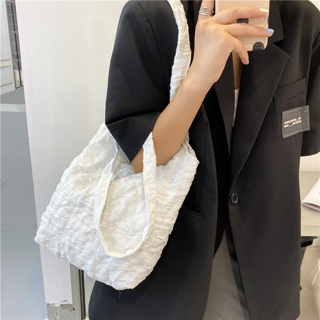 wholesale solid color fold embossing shoulder bag Nihaojewelry NHUA397452's discount tags