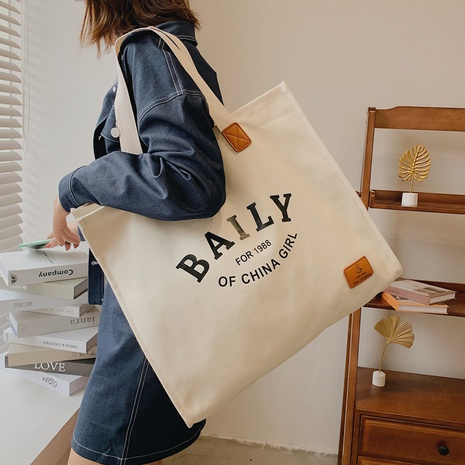 Large-capacity fashion shoulder canvas portable bag wholesale Nihaojewelry NHLH397625's discount tags