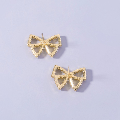 wholesale golden pearl bow copper earrings Nihaojewelry NHDB398391's discount tags