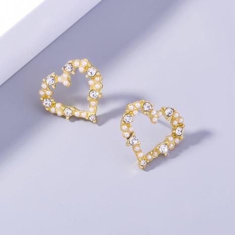 wholesale diamond-studded pearl hollow heart copper earrings Nihaojewelry NHDB398392's discount tags