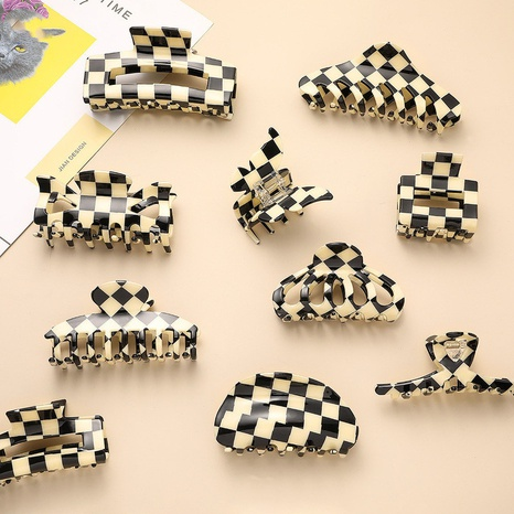 Korean acetate hairpin colored black and white Mige hair accessories hollowed back head plate hair clip NHQIY398917's discount tags