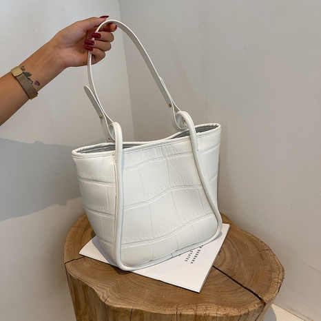 wholesale large capacity solid color stone pattern embossed shoulder tote bag nihaojewelry  NHGN399819's discount tags