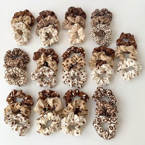 moda leche té color leopardo estampado oso pelo scrunchies al por mayor Nihaojewelry NHOF422650's discount tags