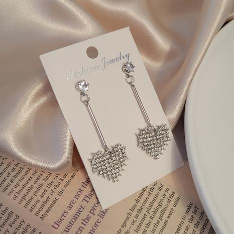 Boucles d'oreilles coeur coréen plein de diamants en gros Nihaojewelry NHSD431296's discount tags