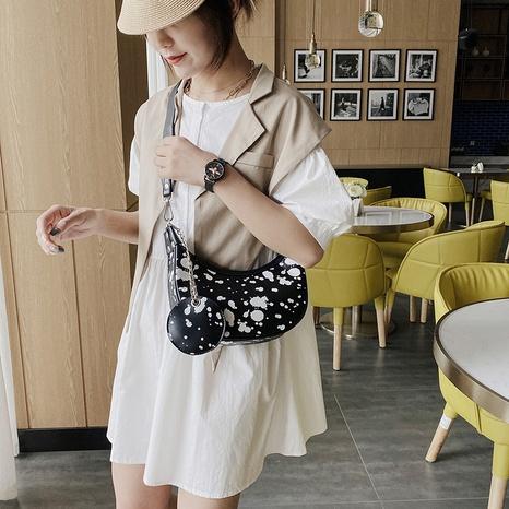 moda salpicaduras tinta vaca patrón contraste color bola de masa hervida bolsa al por mayor nihaojewelry NHAV418063's discount tags