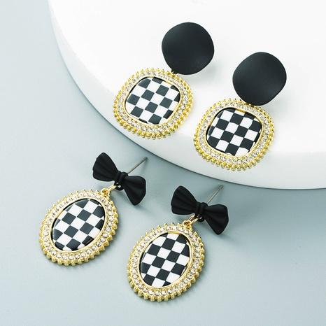 Pendientes de pata de gallo de resina de diamantes de imitación con incrustaciones de aleación simple al por mayor Nihaojewelry NHLN418964's discount tags
