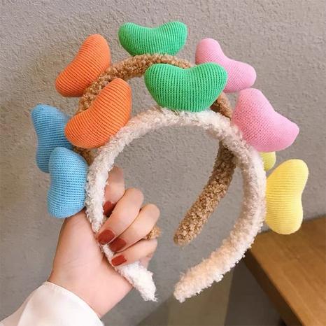 Diadema de tela de corazón de color coreano al por mayor Nihaojewelry NHAQ419643's discount tags