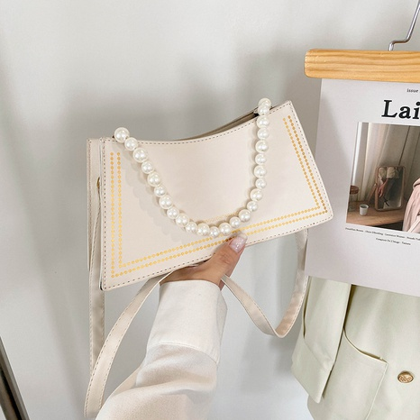 Korean style solid color pearl chain one-shoulder messenger bag wholesale nihaojewelry  NHRU420644's discount tags