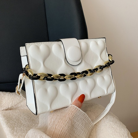 heart shape embossed solid color chain shoulder messenger bag wholesale Nihaojewelry NHRU420655's discount tags