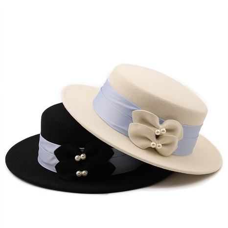 simple pearl bow decoration woolen cloth flat top wholesale Nihaojewelry  NHXV420976's discount tags